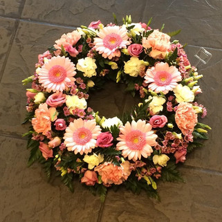 Pink memorial wreaths