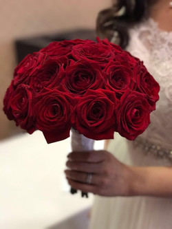 Red Roses in Hand Tied Bouquet