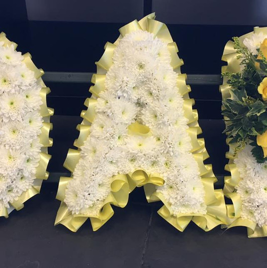 Yellow and White Funeral Letters.jpg