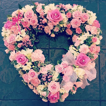Pinks - funeral flowers heart shaped