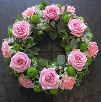 Green Funeral Wreath with Pink Flowers.j