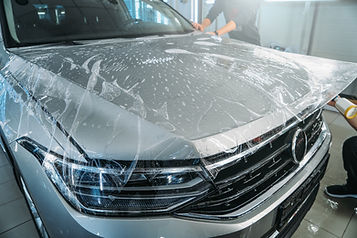 image of Clear Bra / PPF being installed on the hood of an SUV