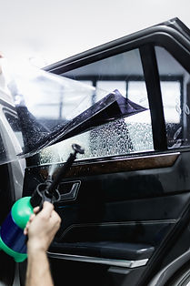 window tint being applied to a car window