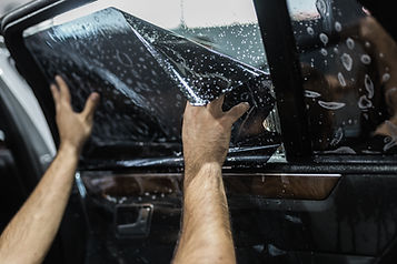 window tint being applied to a vehicles interior window
