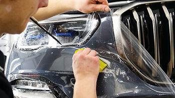 PPF being applied to the bumpper of a car