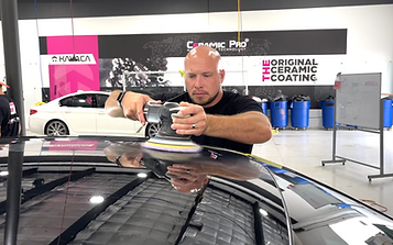 image of a man Paint Correcting / buffing the roof of a car
