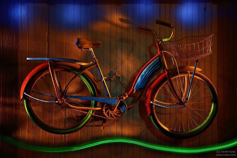 "Beautiful colored lights on a vintage bicycle by ""Light Painting"" artist Xavier Nuez"
