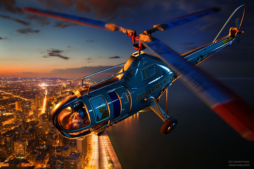 A theatrical and creative artwork of a vintage toy US army helicopter flying over chicago and lake michigan by Xavier Nuez