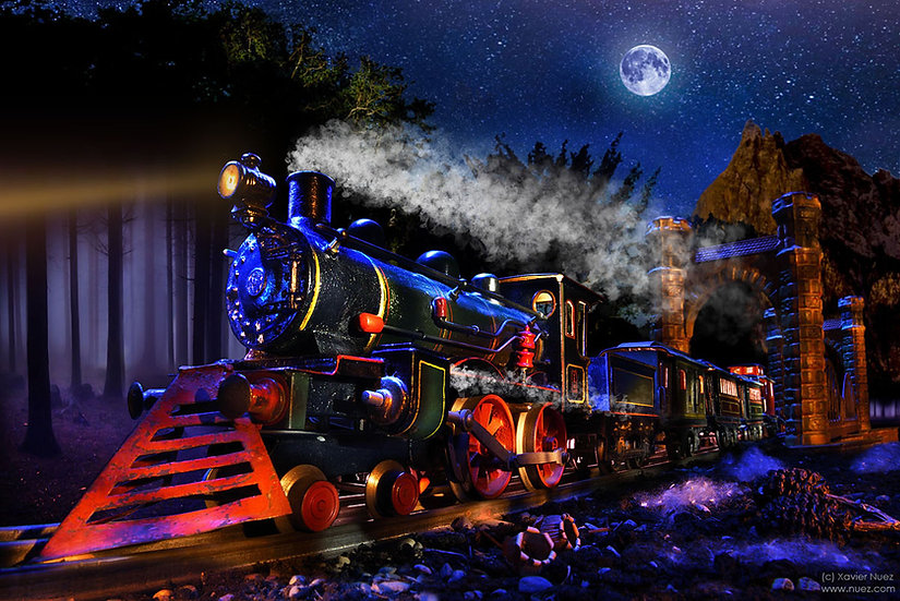 """A Carette """"vintage toy"""" train locomotive on a theatrical set with dramatic lighting by artist Xavier Nuez"""