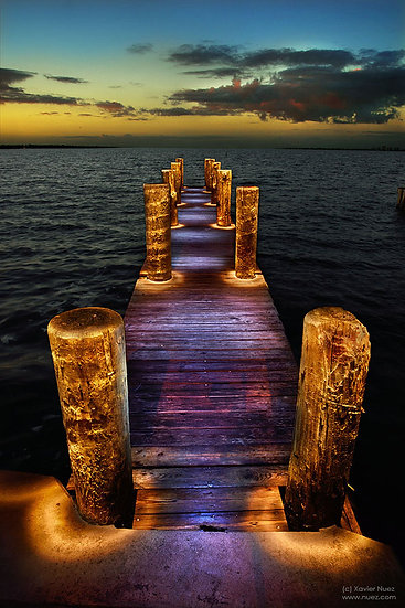 "A peaceful and meditative ""light painting"" of a pier with a body of water stretching out by artist Xavier Nuez"