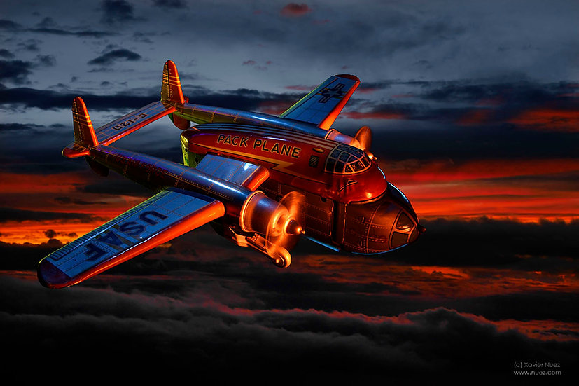 A dramatic and theatrical vintage toy artwork by artist Xavier Nuez of a US air force airplane