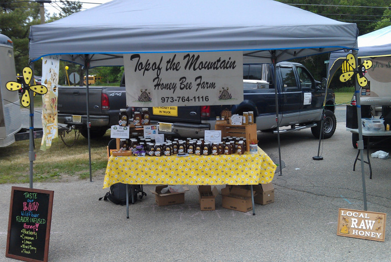 Top of the Mountain Honey Bee Farm's table at the Blairstown Farmers Market.