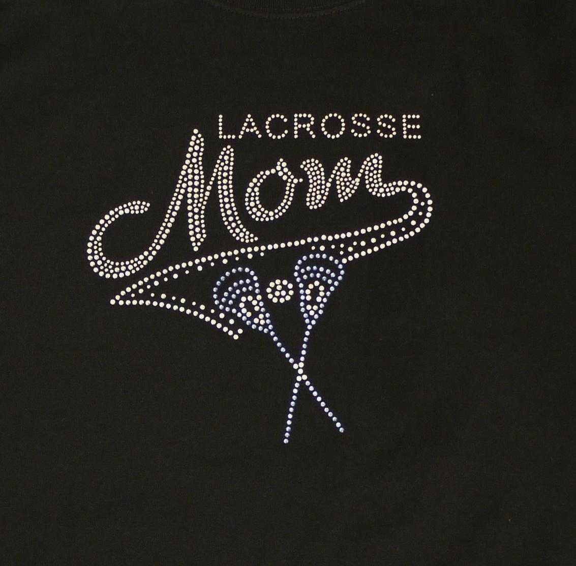 lacrosse mom with blue sticks close up
