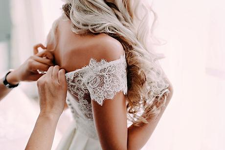 Gorgeous, blonde bride in white luxury d