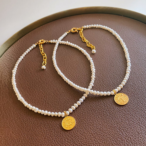 Pearl Necklace with Zodiac Signs