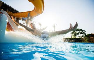 A man sliding down a fun waterslide at Slide and Splash waterpark in Algarve