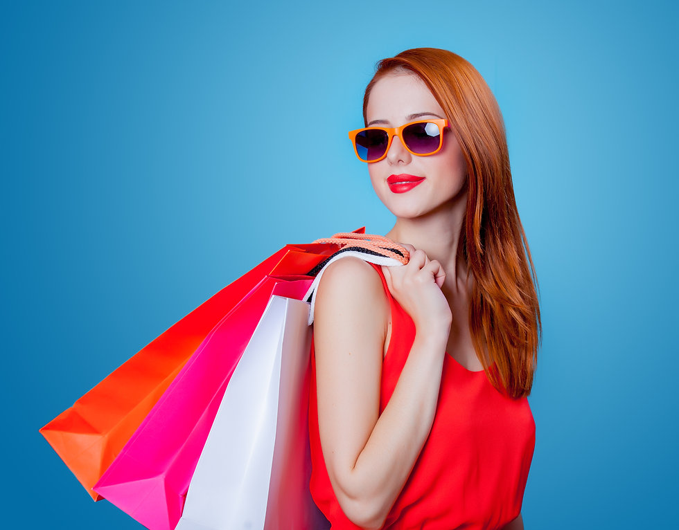 Pretty women with shopping bags.