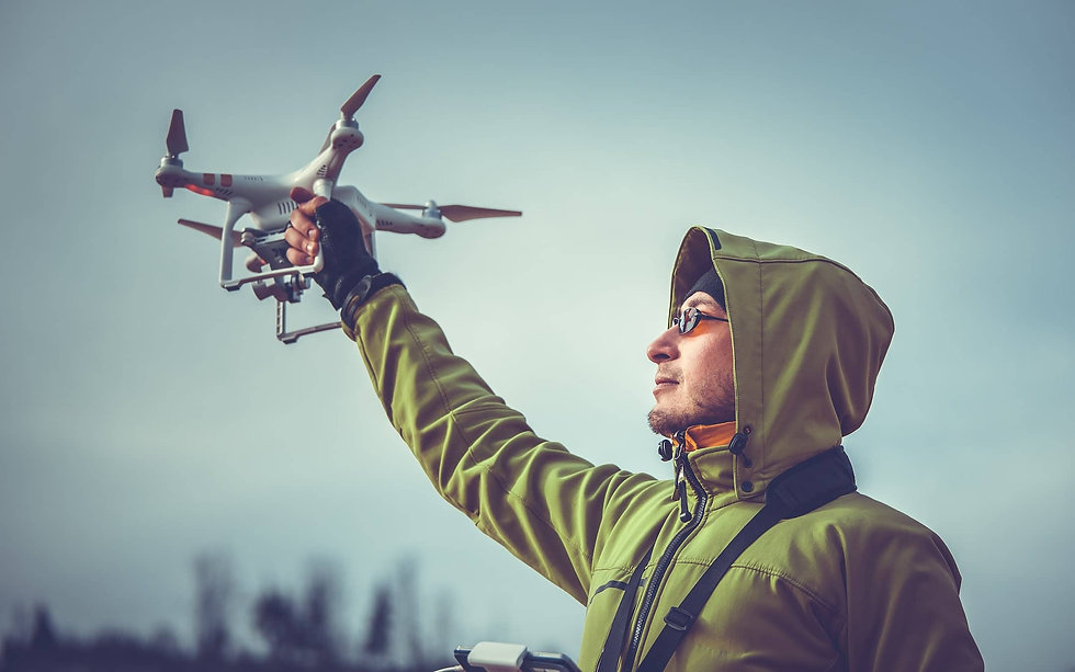 Background_Man_Holding_Drone-min (1).jpg