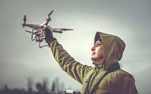 Background_Man_Holding_Drone-min_edited.