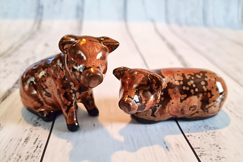 Set of Copper Pigs