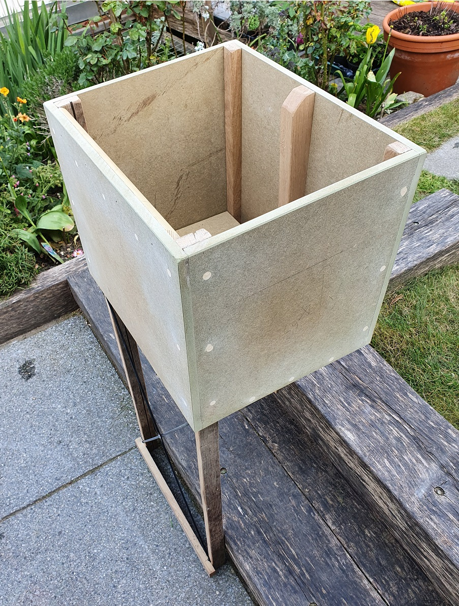 A milk box constructed from waste moisture resistant MDF, oak legs (profiles as found), reclaimed br