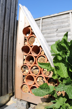 A bug hotel made from waste timber