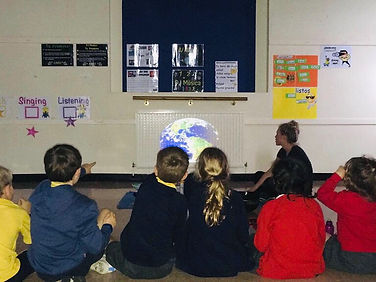 A DJ Musica class, Kate Felton with primary school children, projection of a globe
