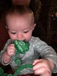 Mikey's kid eating shamrock.JPG