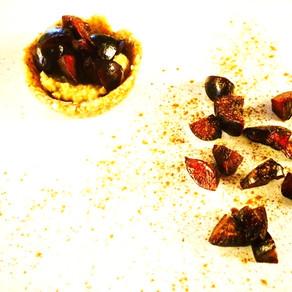 Raw pecan cherry pies with cashew cinnamon cream