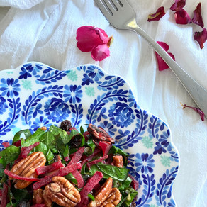 Wilted Kale Salad With Beets, Raisins, And Nuts