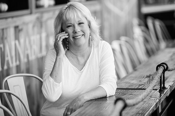 Phyllis Pieri Your Franchise Coach talking on the phone