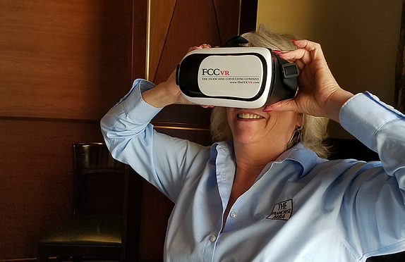 Phyllis PIeri Your Franchise Coach wearing a VR headset
