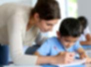teacher-helping-young-student-768.jpg