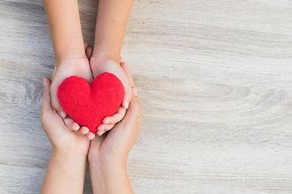 hands holding heart.jpg