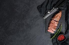 sliced-beef-flank-steak-medium-rare-blac