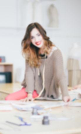 Portrait of Fashion designer working in