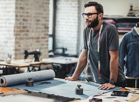 Fashion designer working in his studio.j