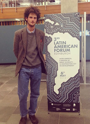 Committee Member with the 2014 Edinburgh Latin American Forum banner