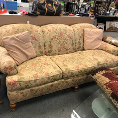 Pink and green floral sofa