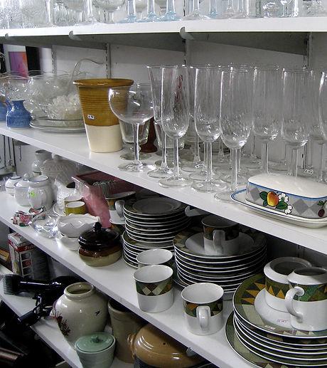 thrift shop glassware plates mugs bowls.