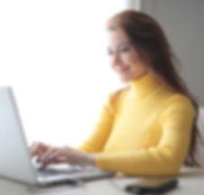 woman-in-yellow-turtleneck-sweater-using