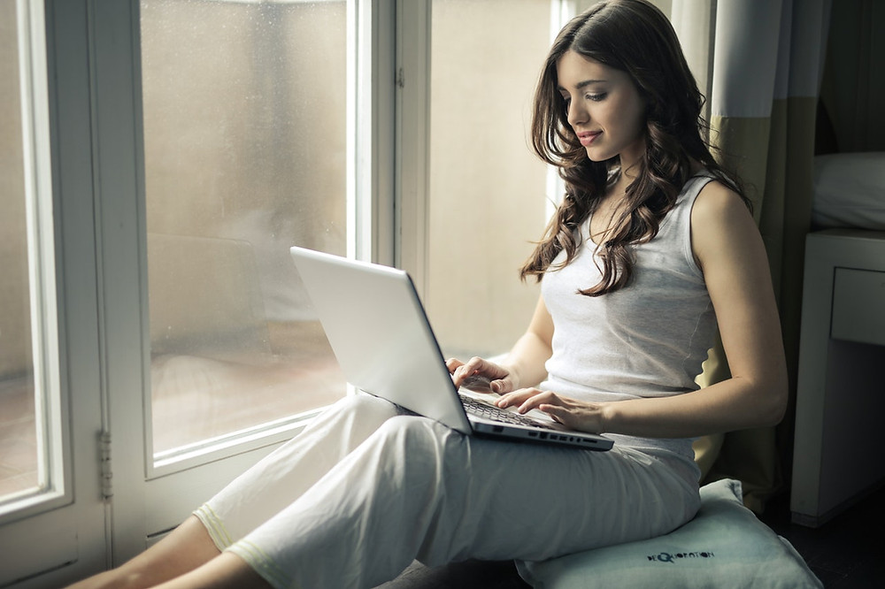 a woman is using laptop