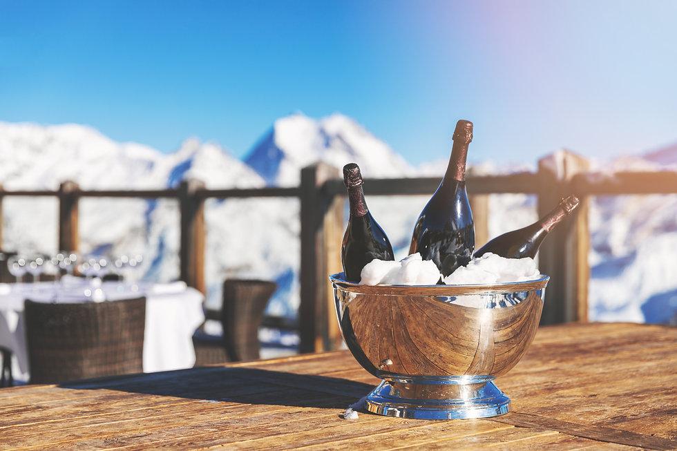 bucket with champagne bottles on restaur