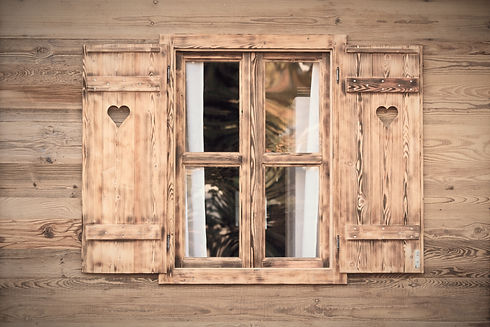 Open%20window%20of%20a%20wooden%20hut%20with%20hearts%20in%20the%20blinds_edited.jpg
