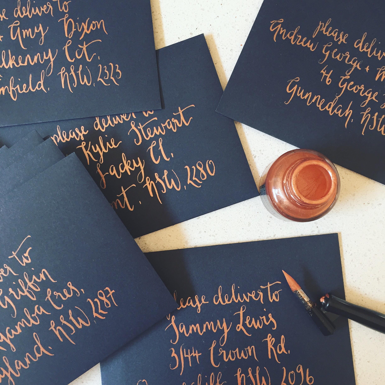 Copper ink on navy envelopes