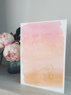 Gold calligraphy on watercolour sign