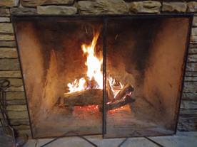 A Cozy Fire Burning InThe Fireplace