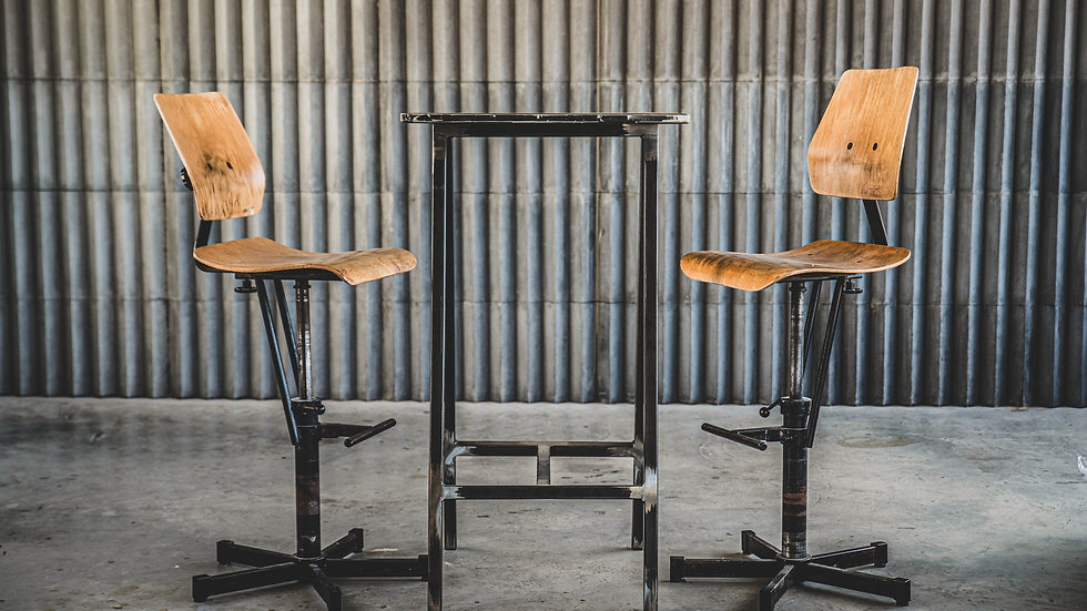 Three Vintage Adjustable BOSCH Workshop Chairs with a Concrete Bar Table