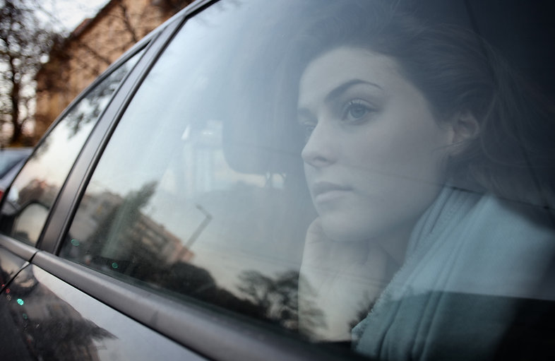 woman-looking-out-the-car-window-3986964