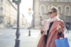 woman-in-brown-coat-wearing-black-sungla
